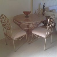 Granite and wrought iron dining table and chairs for sale