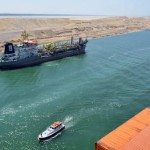 A cargo ship is seen crossing through the New Suez Canal, Ismailia, Egypt, July 25, 2015. The first cargo ships passed through Egypt's New Suez Canal on Saturday in a test-run before it opens next month, state media reported, 11 months after the army began constructing the $8 billion canal alongside the existing 145-year-old SuezCanal. Mohab Mameesh, chairman of the Suez Canal Authority overseer of the project, told state television that this test-run had been a success and that more would follow. REUTERS/Stringer
